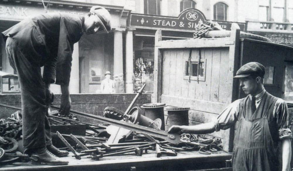 Bill Cope removing the original Exchange Building clock, circa 1928.