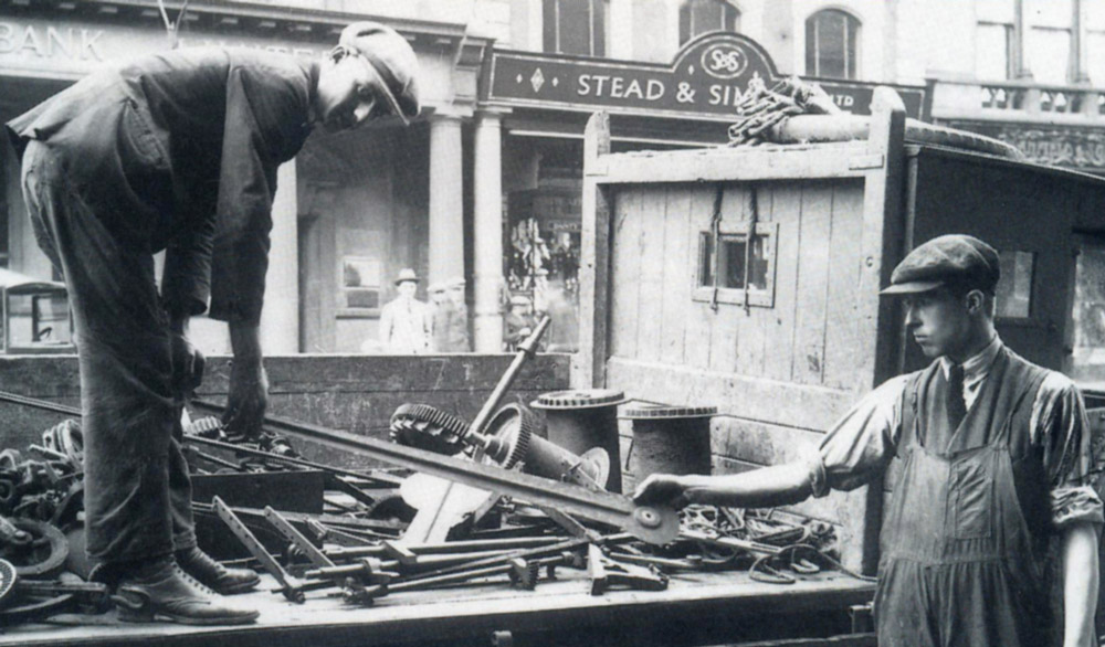 Bill Cope removing the original Exchange Building clock, circa 1928.